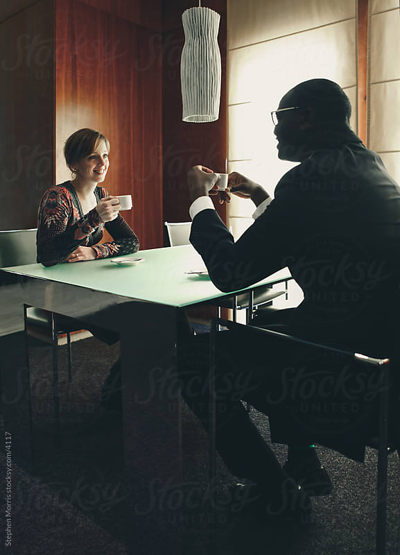 Couple Having Coffee by Stephen Morris for Stocksy United