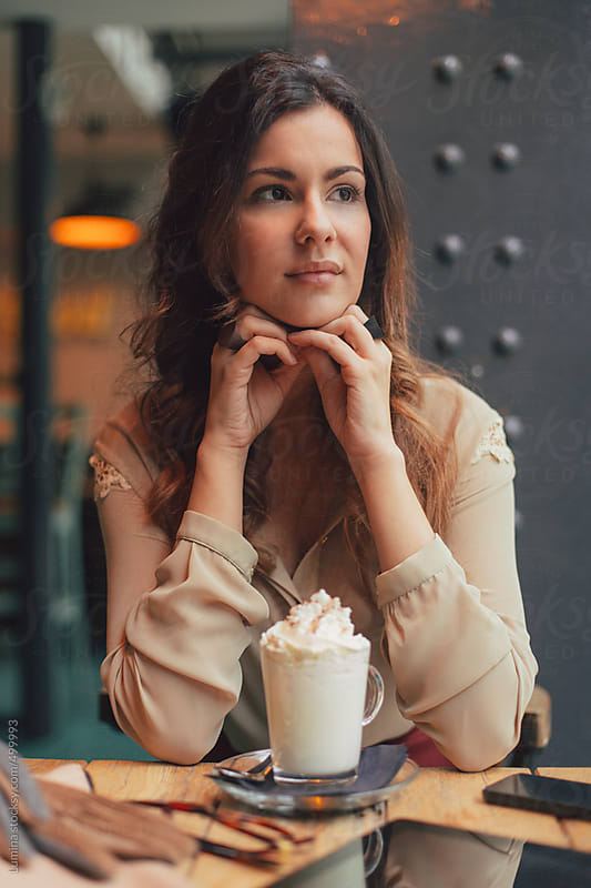 Beautiful Woman Sitting at a Coffee Shop by Lumina for Stocksy United