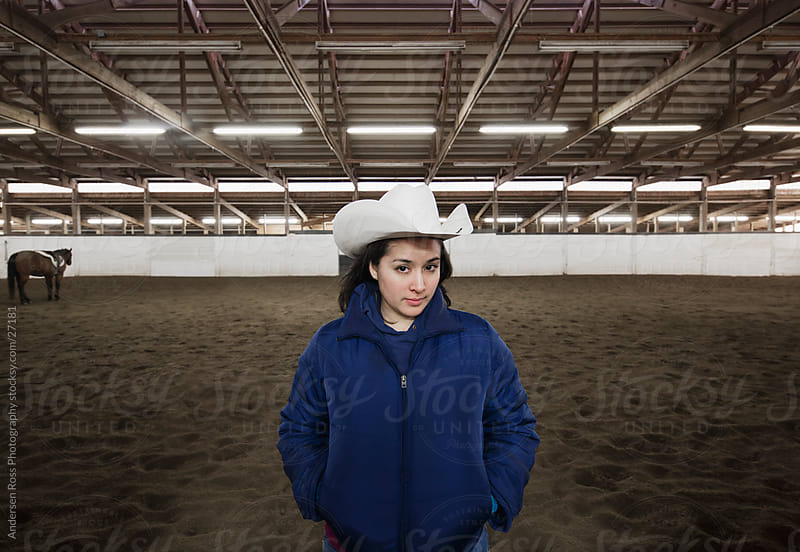 Woman in an equestrian center by Andersen Ross Photography for Stocksy United