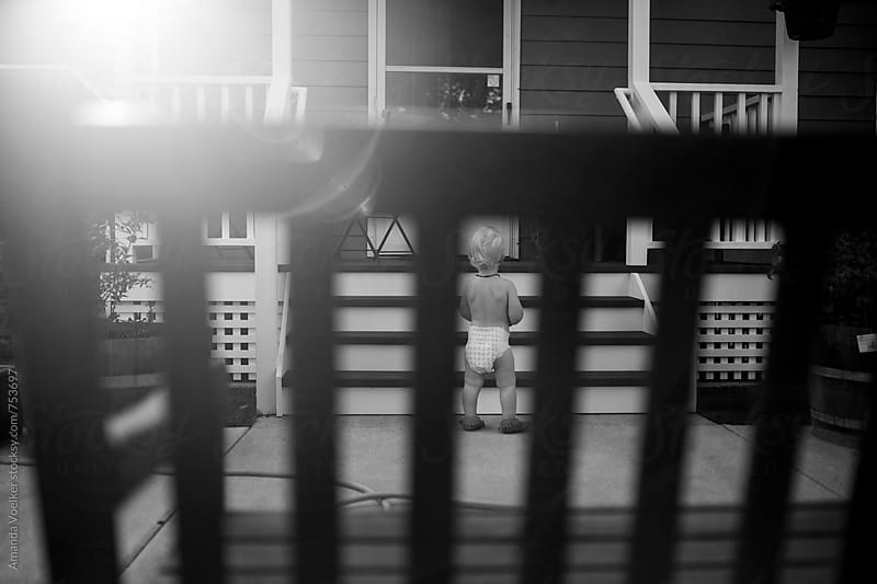 Toddler Boy Waits at the Bottom of the Front Steps  by Amanda Voelker for Stocksy United