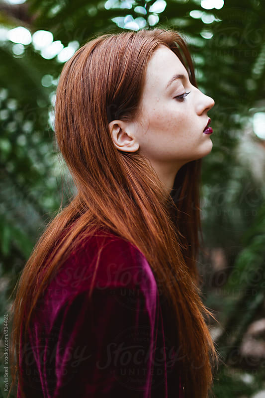 Beautiful redhead in a greenhouse by Kayla Snell for Stocksy United