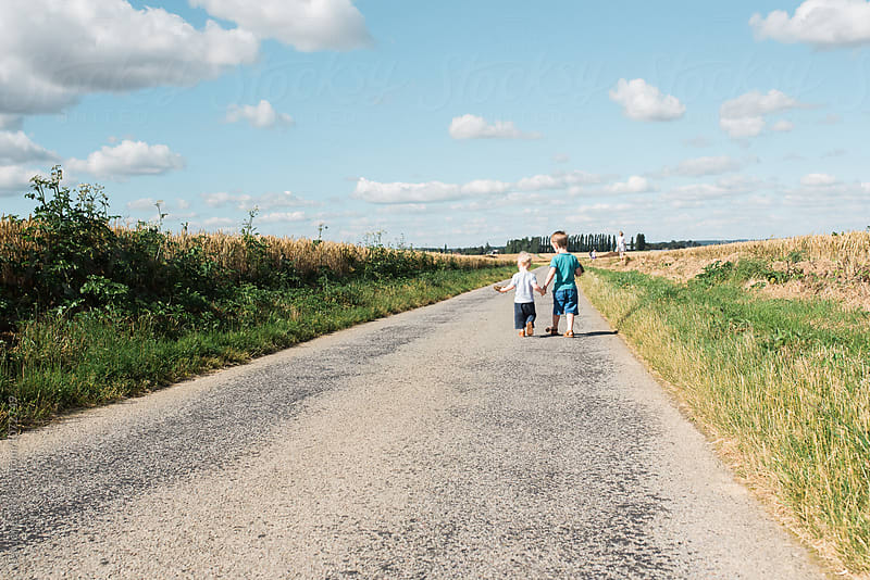 children on a walk in the summer little boys holding hands. by Léa Jones for Stocksy United