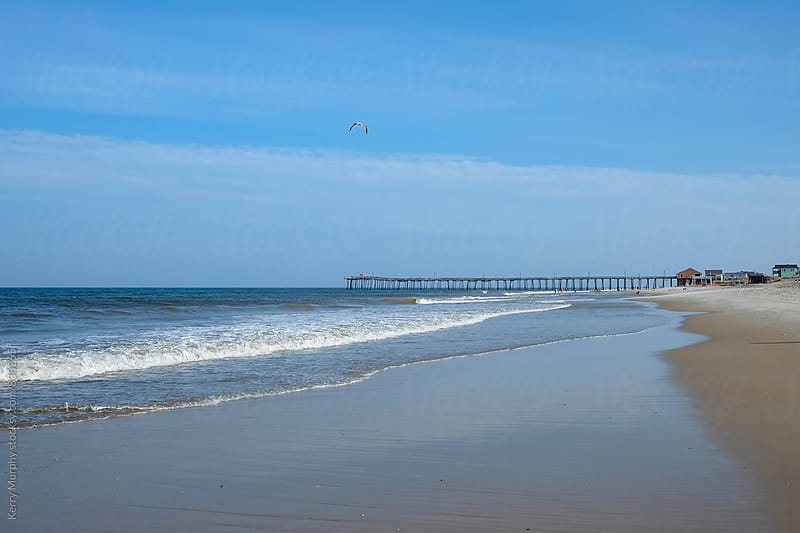 View of atlantic ocean and fishing pier by Kerry Murphy for Stocksy United
