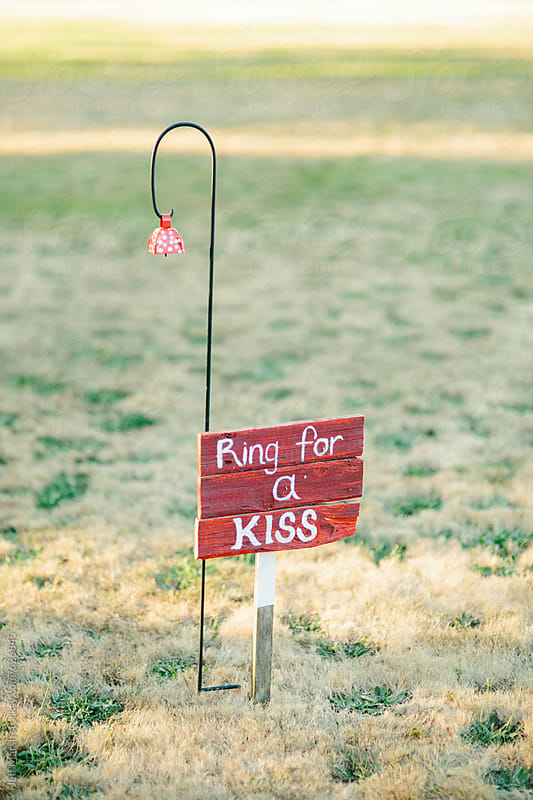 Ring for a kiss sign by Jeff Marsh for Stocksy United
