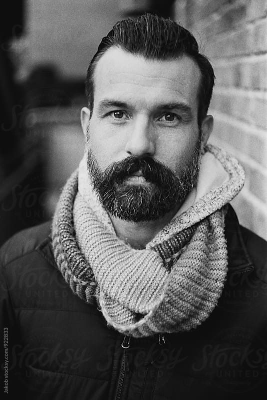 Black and white portrait of a handsome man with a beard by Jakob for Stocksy United