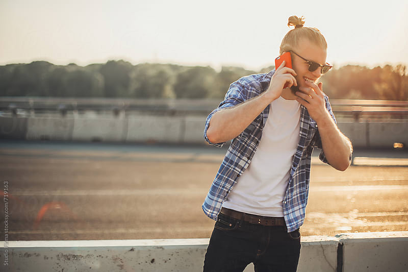 Young Happy Man Making a Call. by Studio Firma for Stocksy United