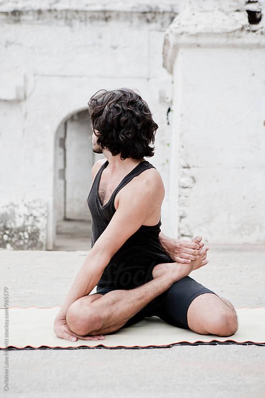 Man doing yoga by Christine Love Hewitt for Stocksy United