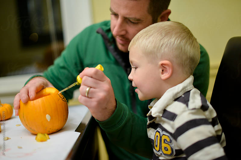 Boy and Dad Halloween Pumpkin Carving by JP Danko for Stocksy United