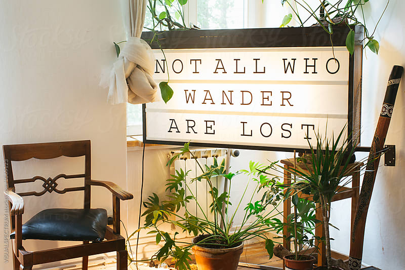 Original Berlin Living Room Detail - Sign With the Words 'Not All Who Wander Are Lost' by Julien L. Balmer for Stocksy United