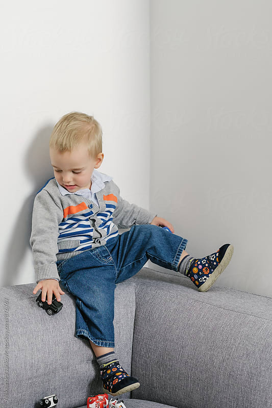 Cute Little Baby Boy Playing with Toy Cars by Aleksandra Jankovic for Stocksy United
