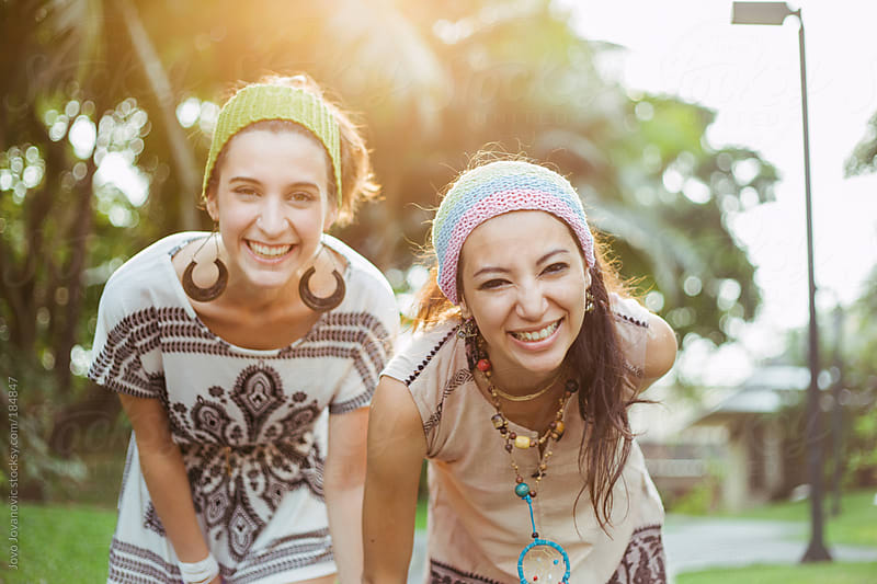 Friendship - two girls enjoying summer day in the park by Jovo Jovanovic for Stocksy United