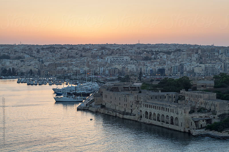 Malta - View from Valletta towards Fort Manoel, Gżira and Ta' Xbiex at Sunset by Tom Uhlenberg for Stocksy United