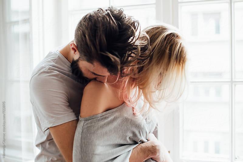 Bearded Man Hugging His Girlfriend by Nemanja Glumac for Stocksy United