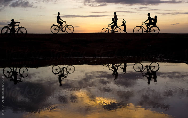 Boys enjoying cycle riding and palying by PARTHA PAL for Stocksy United