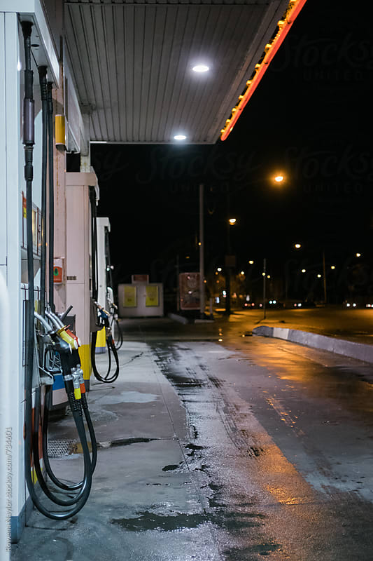 Empty gas station at night by Rowena Naylor for Stocksy United