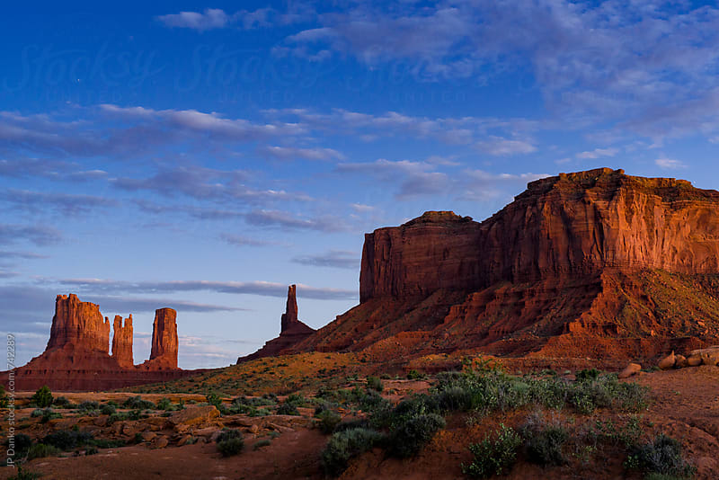 Monument Valley Utah USA Landscape in Late Evening Lit by Moon Light under Stars & Cloudy Sky by JP Danko for Stocksy United