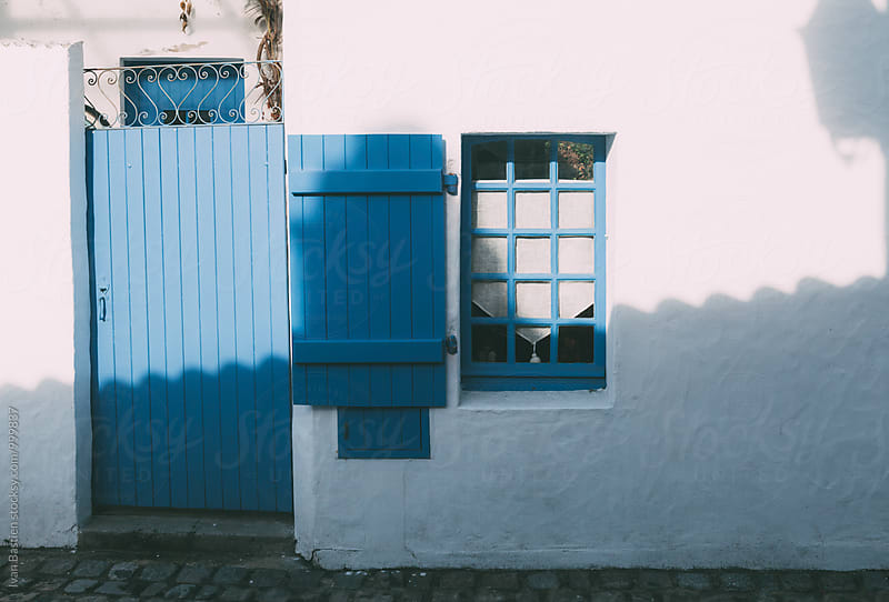 Old house with blue shutters on Noirmoutier Island in France by Ivan Bastien for Stocksy United
