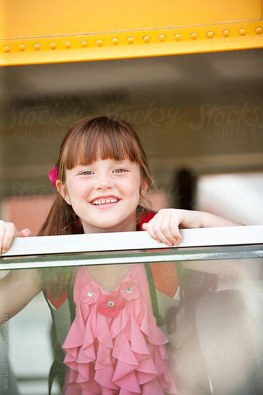 School Bus: Cute Girl Looks At Camera by Sean Locke for Stocksy United