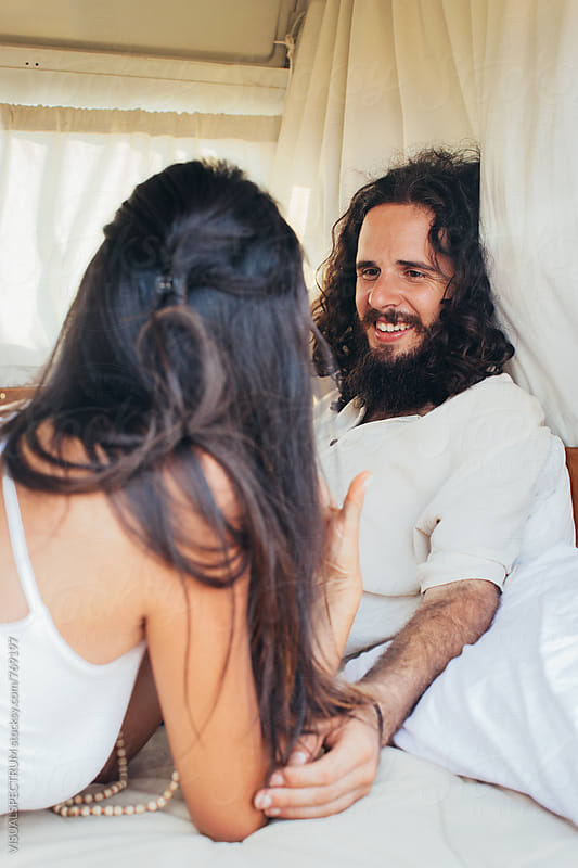 Bearded Male Hippie And Girlfriend Enjoying Themselves in White Stylish Camper Van by Julien L. Balmer for Stocksy United