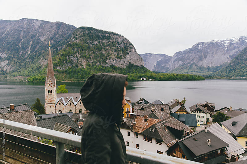 Unrecognizable tourist against of Austrian village in mountains by Andrey Pavlov for Stocksy United