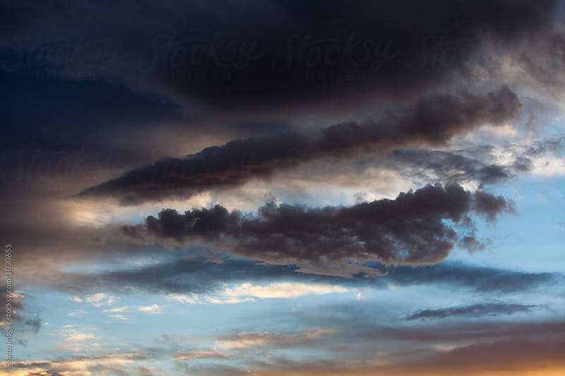 Dark and stormy sky at dusk, Utah by Paul Edmondson for Stocksy United