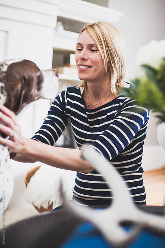 A woman and her dog. by Cherish Bryck for Stocksy United