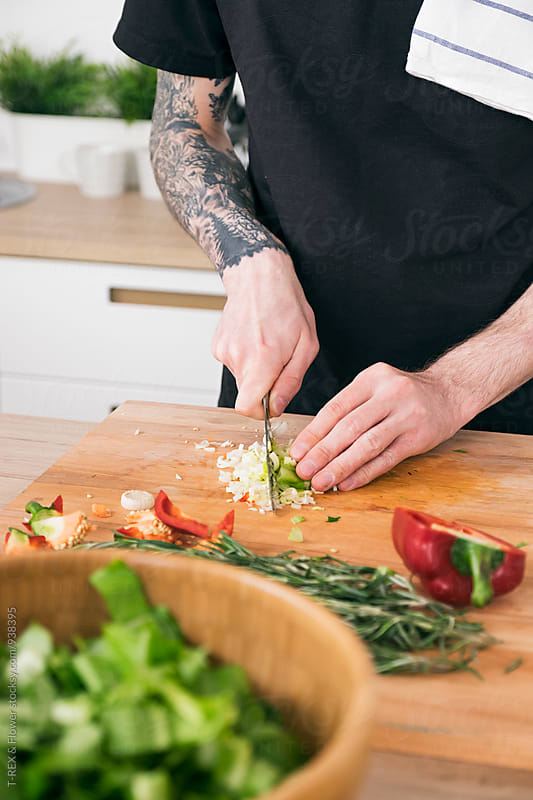 Unrecognizable man cooking in close-up by T-REX & Flower for Stocksy United