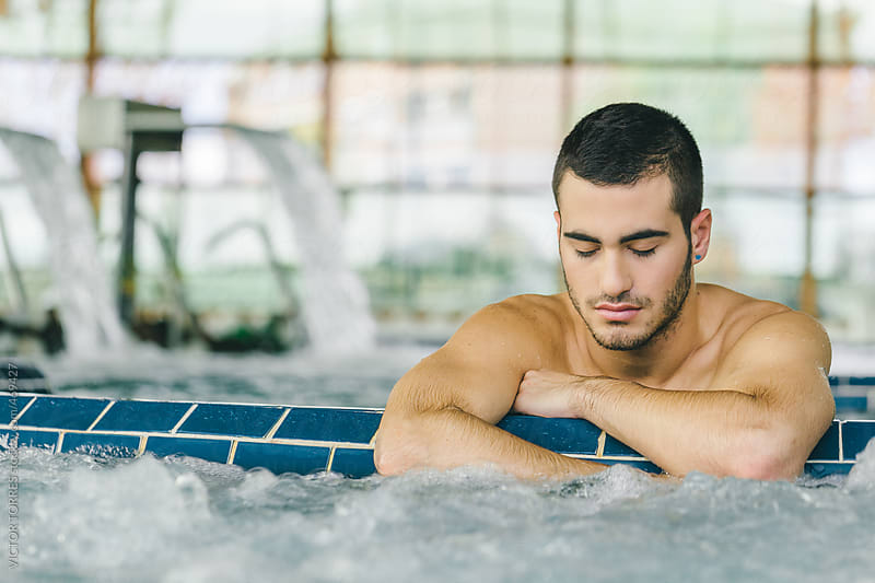 Handsome Man Relaxing in a Spa Center by VICTOR TORRES for Stocksy United