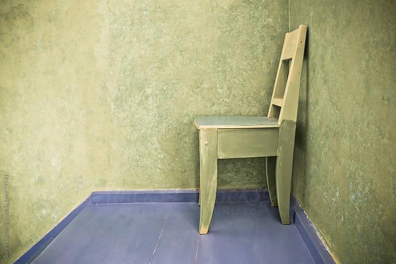 Wooden Chair in stair case in european home interior in Copenhagen Denmark by Soren Egeberg for Stocksy United