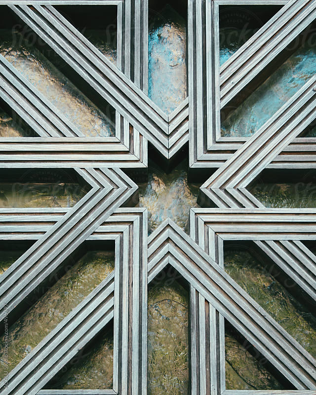 Detail of wooden star in Mosque of Cordoba window by ACALU Studio for Stocksy United