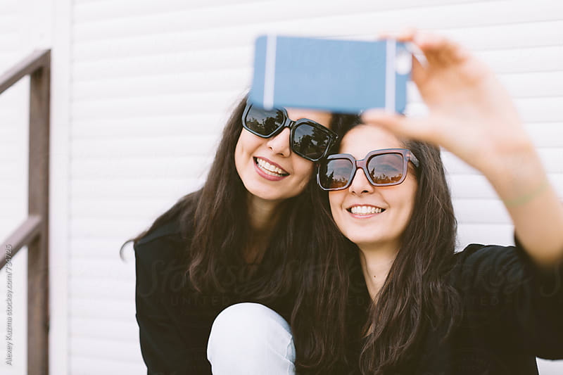 young women making a selfie . by Vesna for Stocksy United