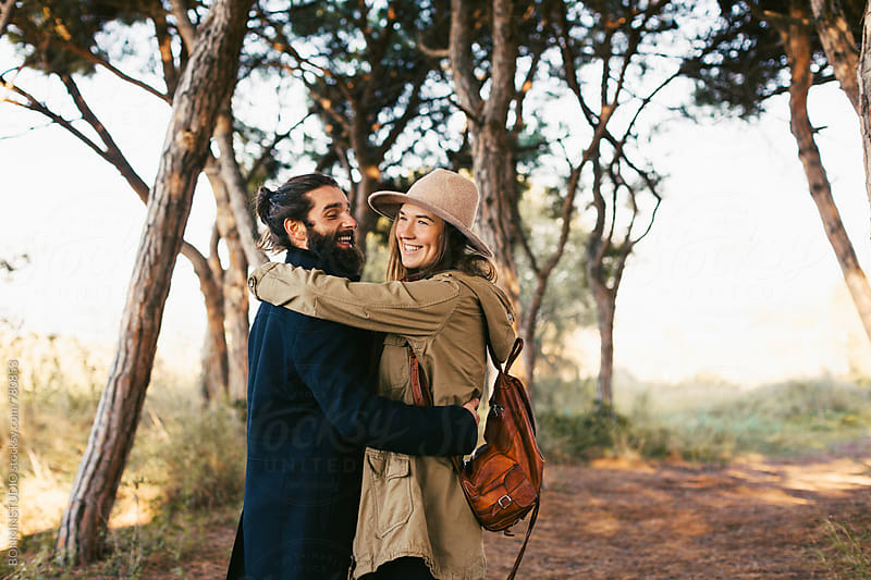 Young hipster couple dancing in the forest. by BONNINSTUDIO for Stocksy United