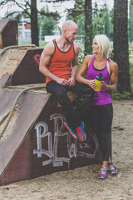 fit couple resting after workout by Andreas Gradin for Stocksy United