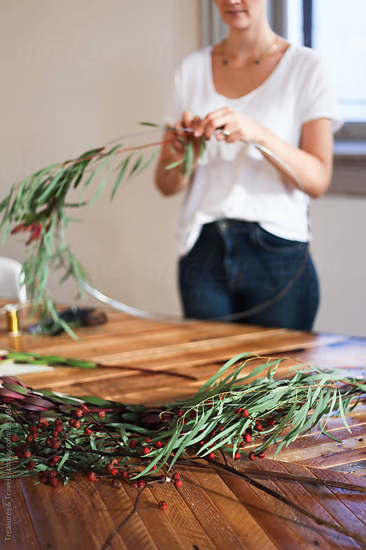 Woman making a Holiday Wreath by Treasures & Travels for Stocksy United