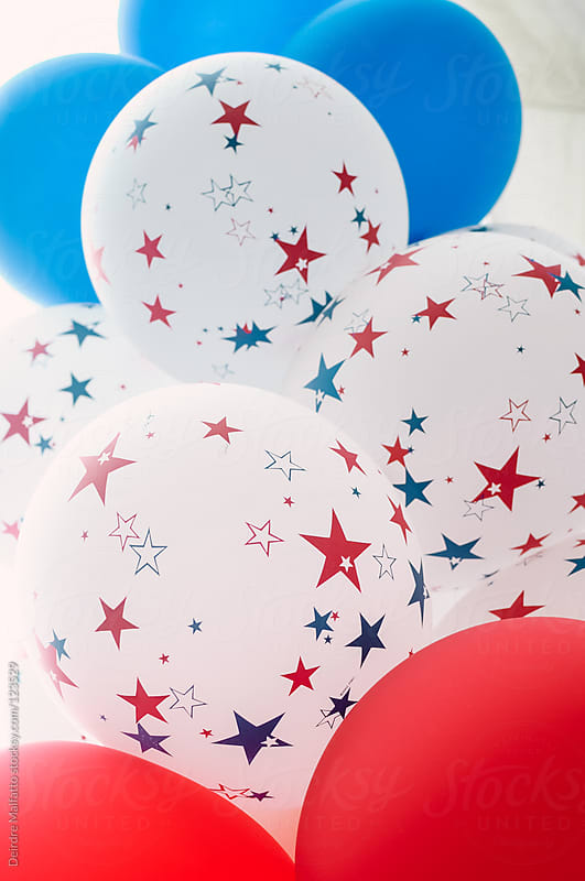 Red, white, and blue balloons for the Fourth of July by Deirdre Malfatto for Stocksy United