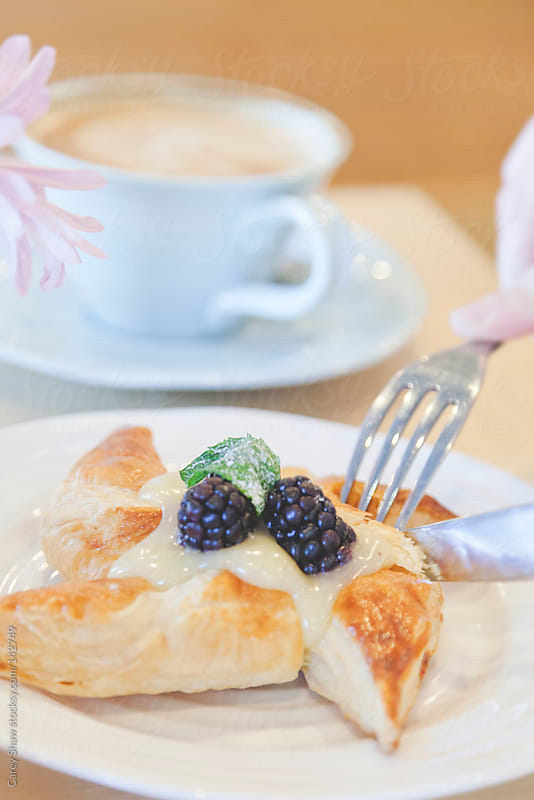 Pastry and coffee by Carey Shaw for Stocksy United