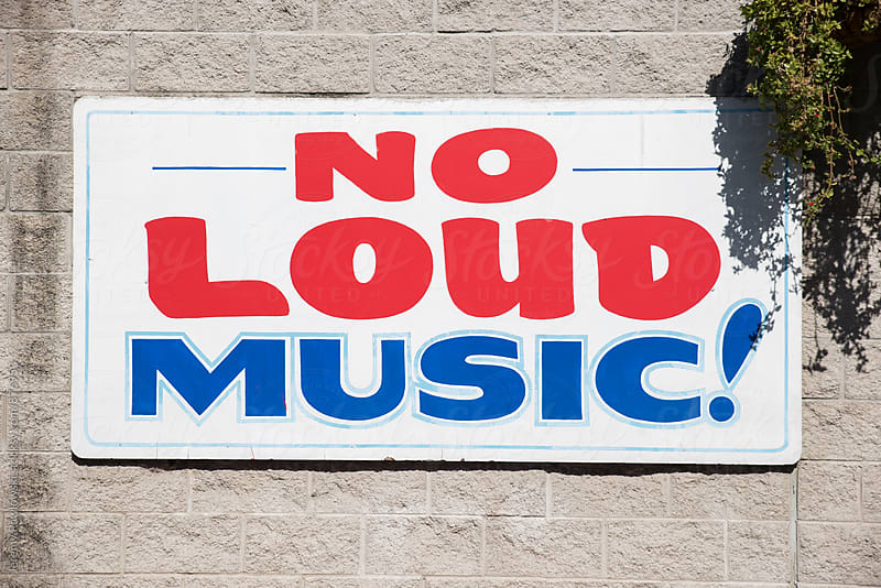 Hand painted no loud music sign on wall by Jeremy Pawlowski for Stocksy United