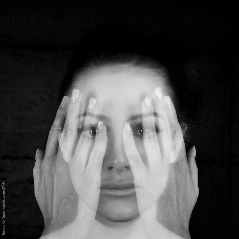 Girl covering face- Mulitple exposures by Robert Kohlhuber for Stocksy United