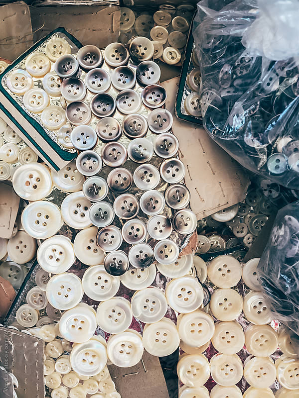 Pile of mother of pearl buttons by Vera Lair for Stocksy United
