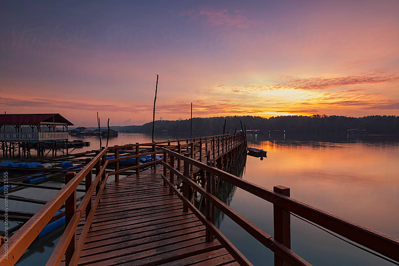 Morning Sunrise at Fishing Jetty by Jacobs Chong for Stocksy United