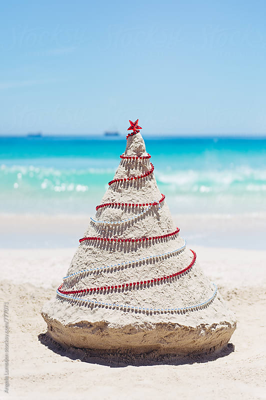 Christmas tree made out of sand at the beach in Western Australia at Christmas by Angela Lumsden for Stocksy United