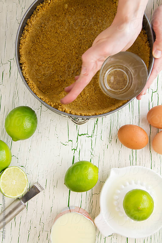 Making a graham cracker pie crust by Kirsty Begg for Stocksy United