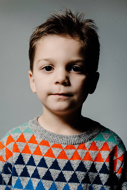 Handsome young boy studio portrait by Cameron Whitman for Stocksy United