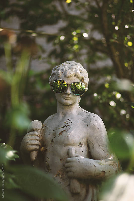 Greek god with sunglasses by Marcel for Stocksy United