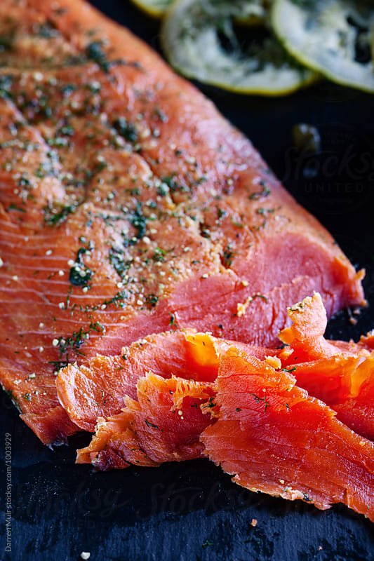 Hand sliced homemade gravlax. by Darren Muir for Stocksy United