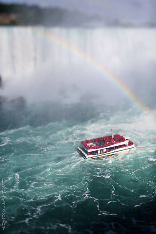 A Boat Full Of Tourists Traveling Though Niagara Falls by ALICIA BOCK for Stocksy United