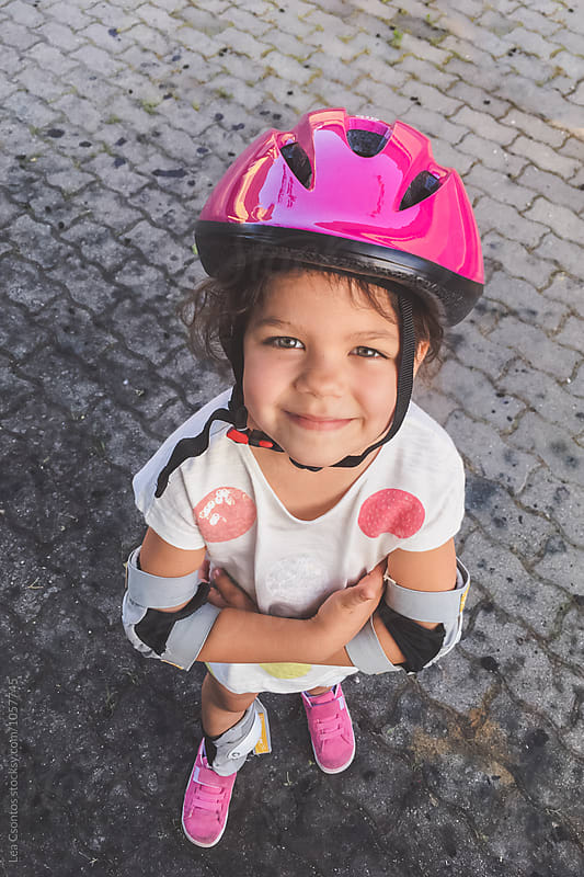 Little girl ready for a bike ride by Lea Csontos for Stocksy United