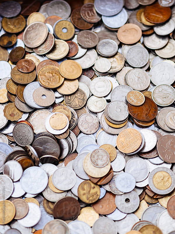 Old coins from different countries  by Juri Pozzi for Stocksy United
