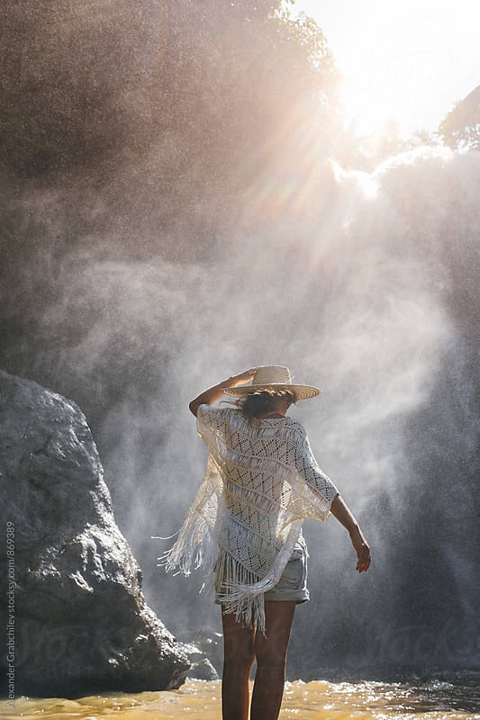 Woman Standing by a Waterfall by Alexander Grabchilev for Stocksy United