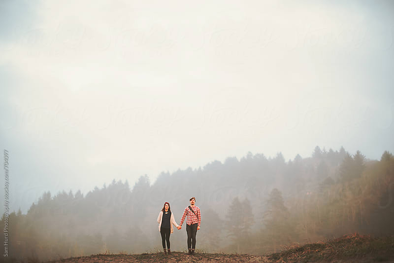 in the fog, in front of the forest by Sam Hurd Photography for Stocksy United